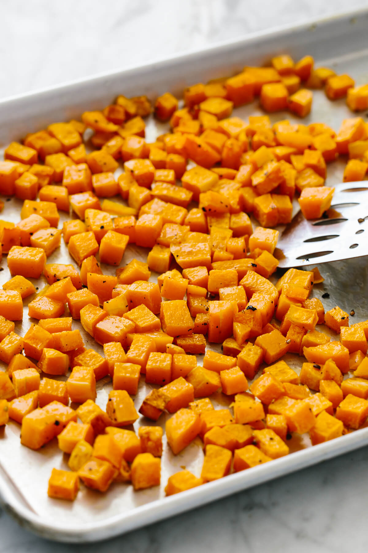 Roasted butternut squash cubes fresh out of the oven.