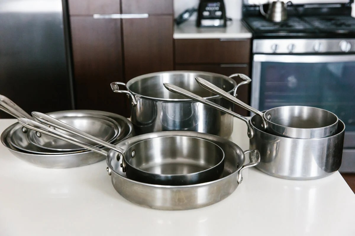 Set of stainless steel cookware.