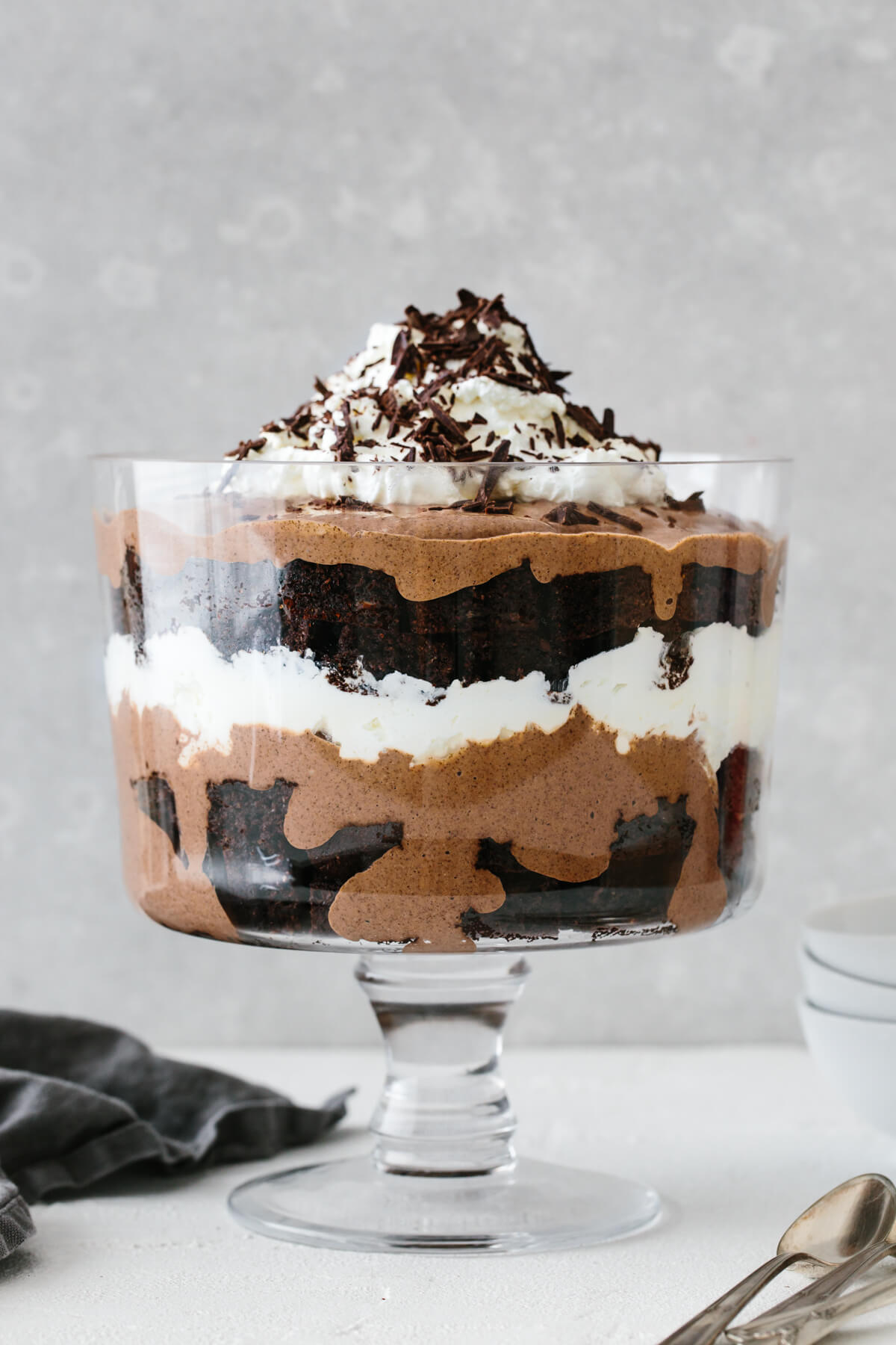 A layered brownie trifle in a trifle bowl.