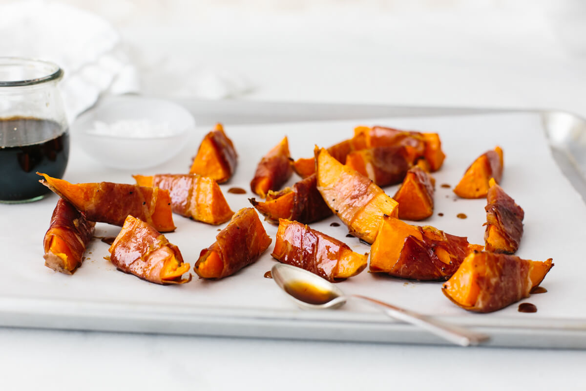 Prosciutto wrapped sweet potatoes drizzled with maple balsamic glaze.