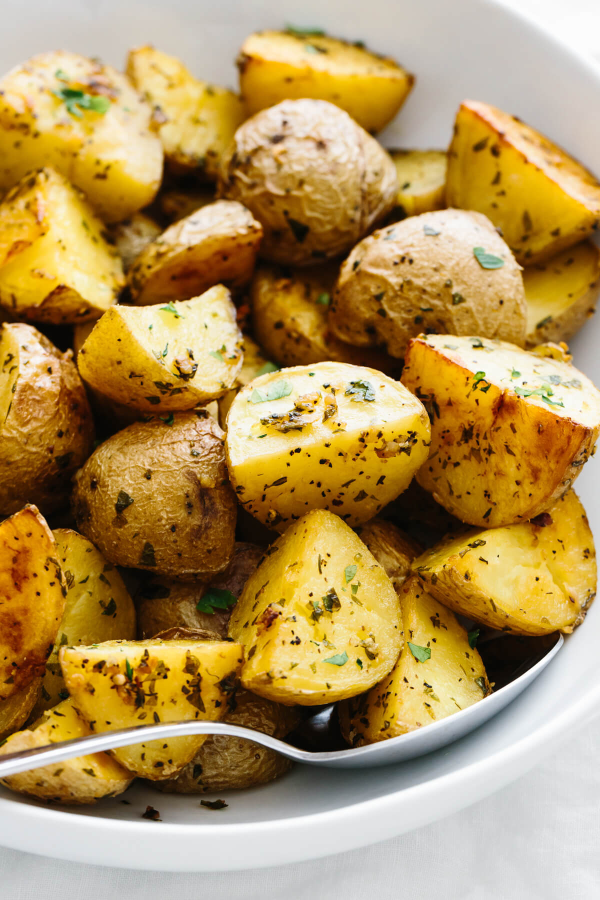Garlic herb roasted potatoes in a bowl.