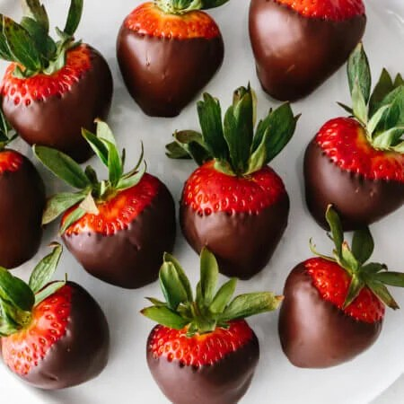 Chocolate covered strawberries on a plate.