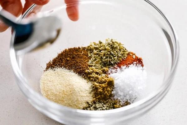 Mixing the fajita seasoning in a bowl.
