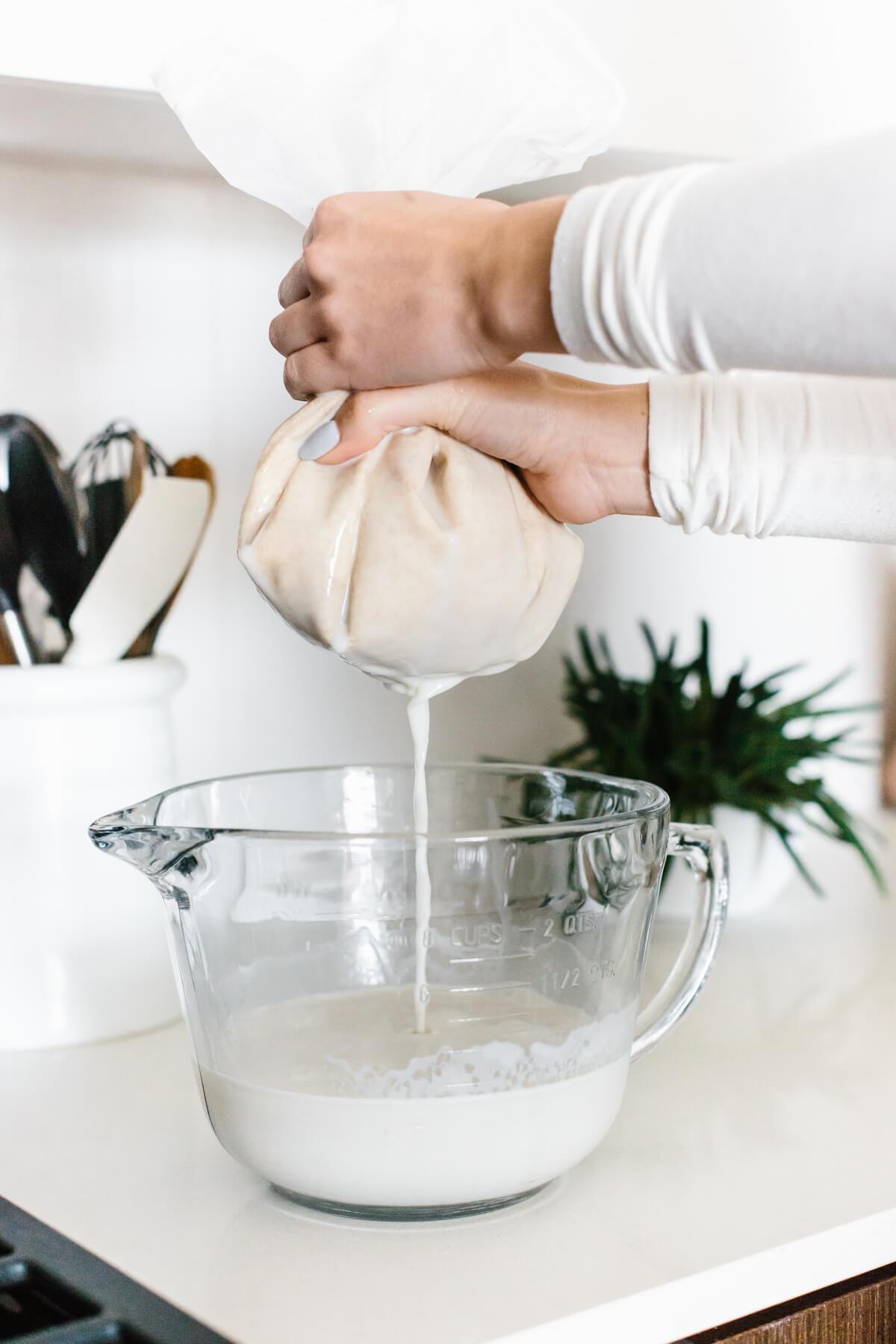 Straining oat milk recipe.