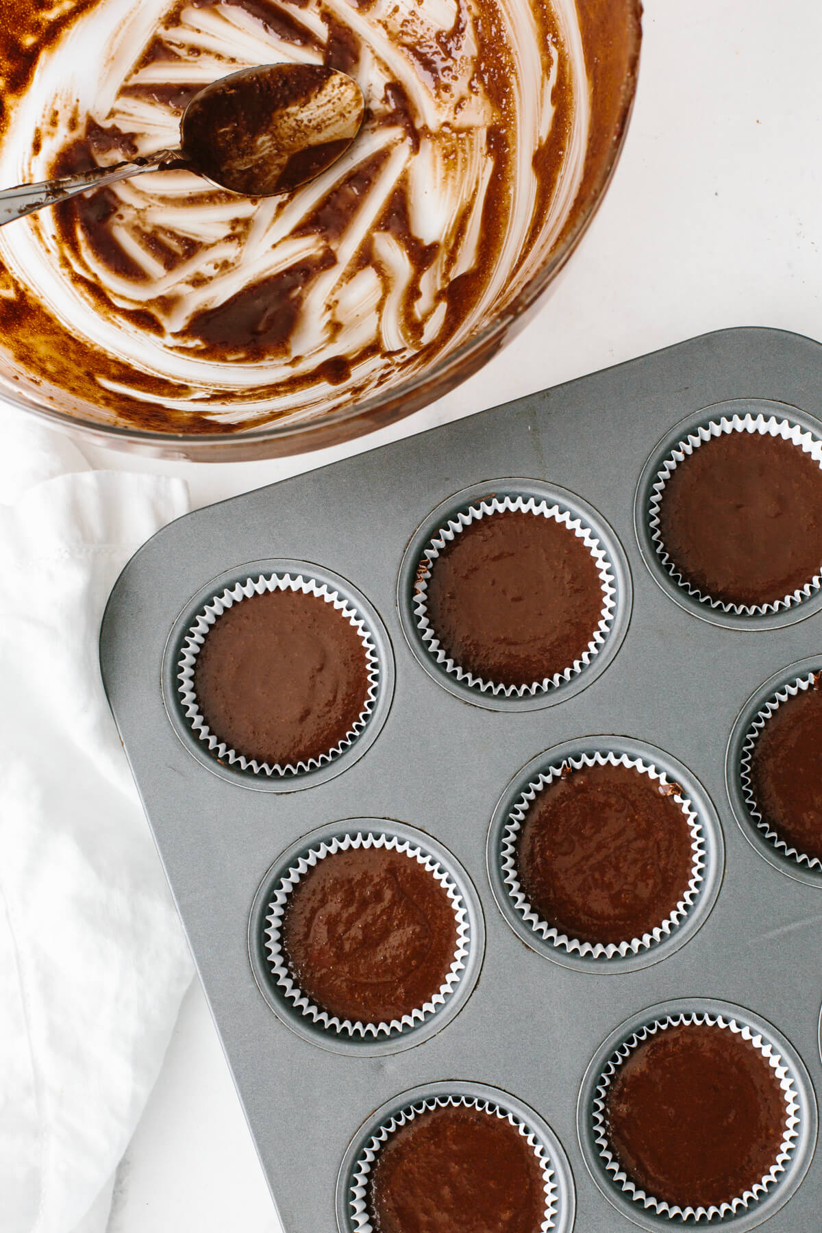 Filling the cupcake pan with chocolate batter.