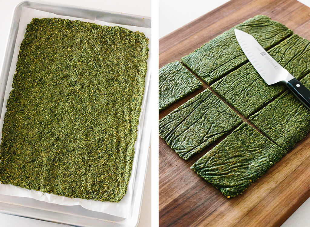 Slicing falafel flatbread on cutting board.