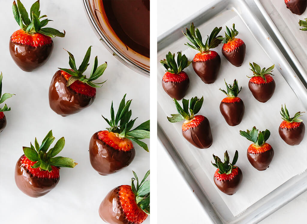 Making chocolate covered strawberry and placing on a plate.