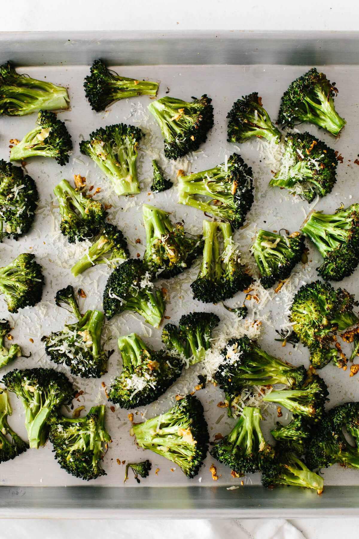 Roasted broccoli on a sheet tray.
