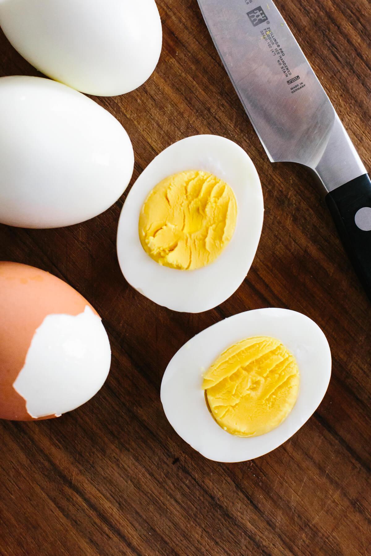 Slicing hard boiled eggs in half.