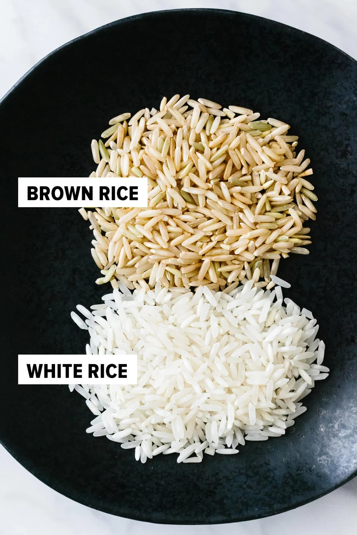 Brown rice and white rice on a plate.