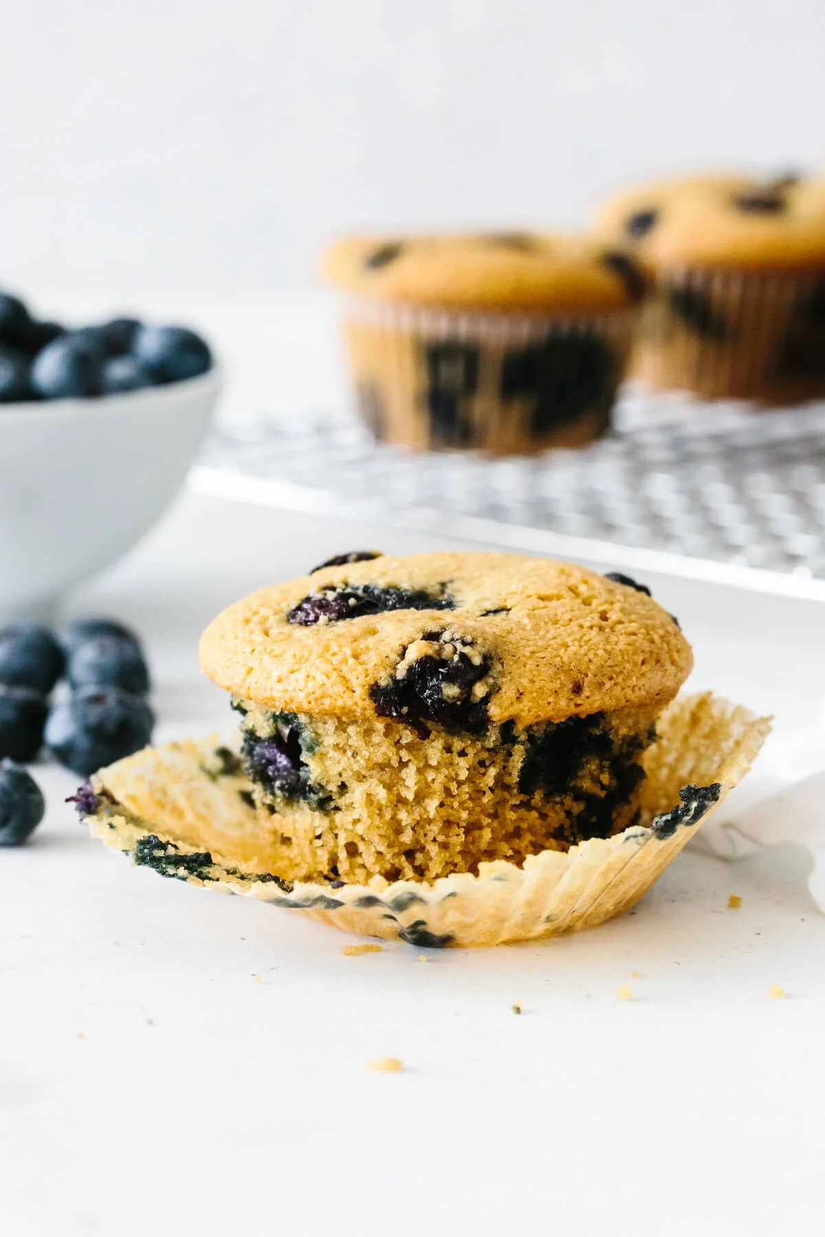 One paleo blueberry muffin with wrapper peeled.