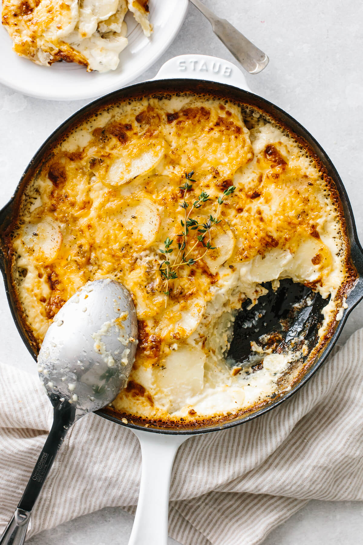 Scalloped potatoes in a pan.