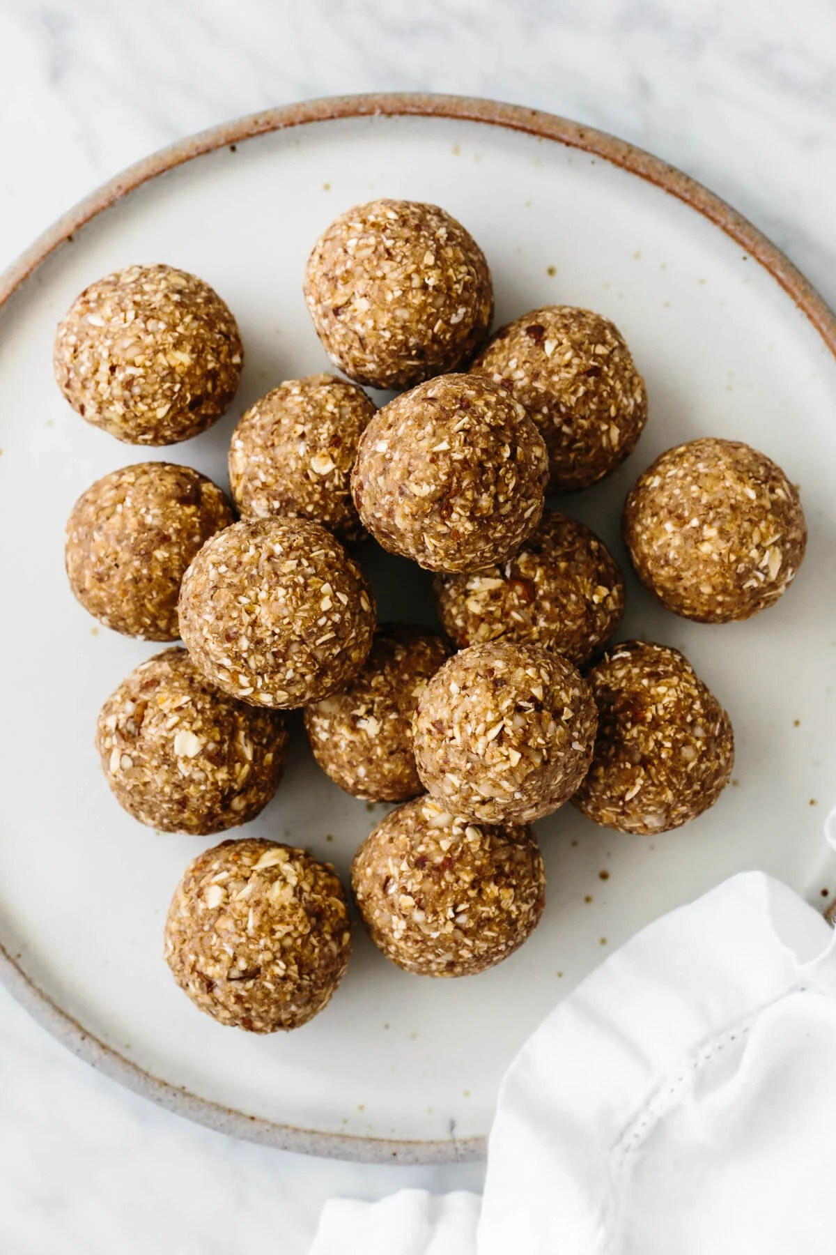 A stack of energy balls on a white plate.