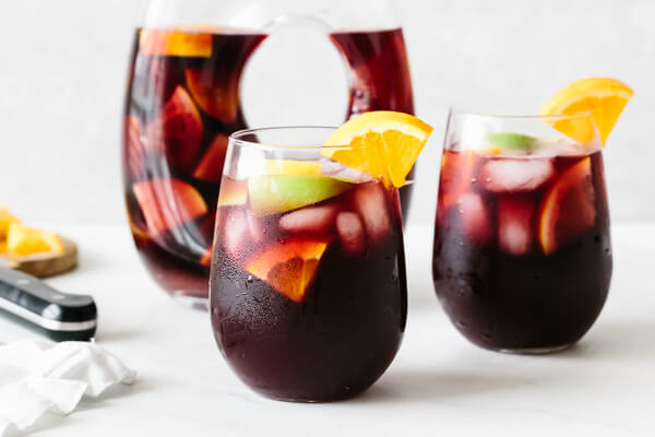 Sangria poured into individual glasses.