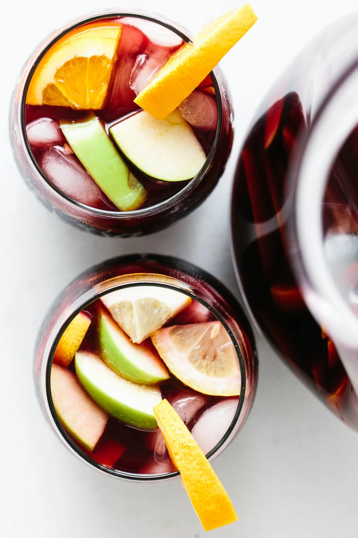 Top down view of two glasses of sangria.