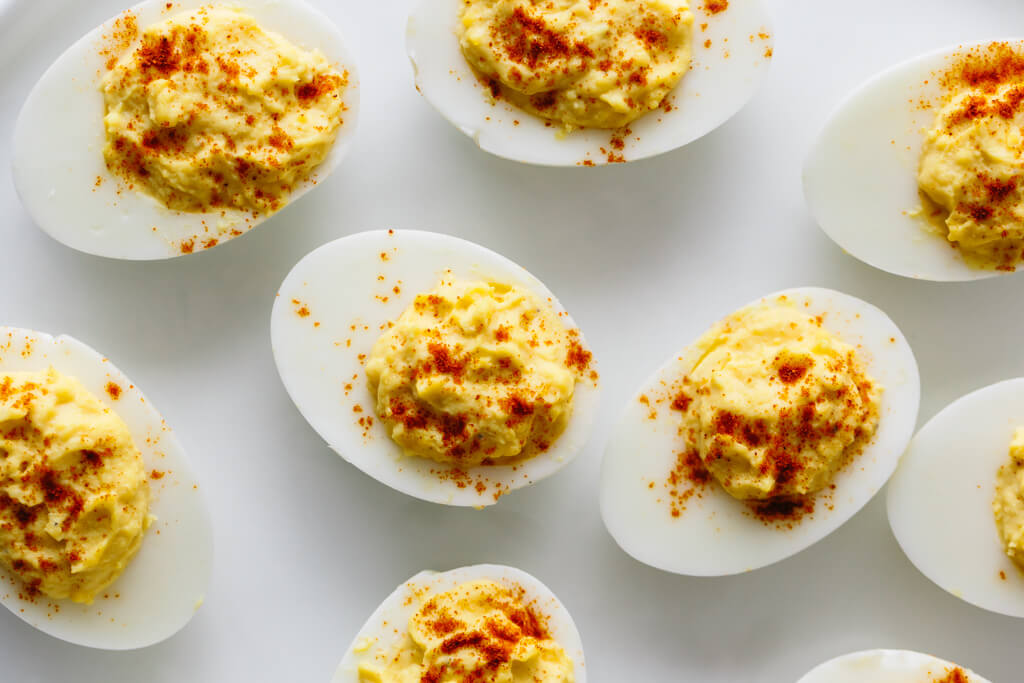 Deviled eggs are hard boiled eggs where the yolk is mixed with mayonnaise, mustard, vinegar, salt and pepper. A little sprinkle of paprika on top helps make these the best deviled eggs recipe for Easter.