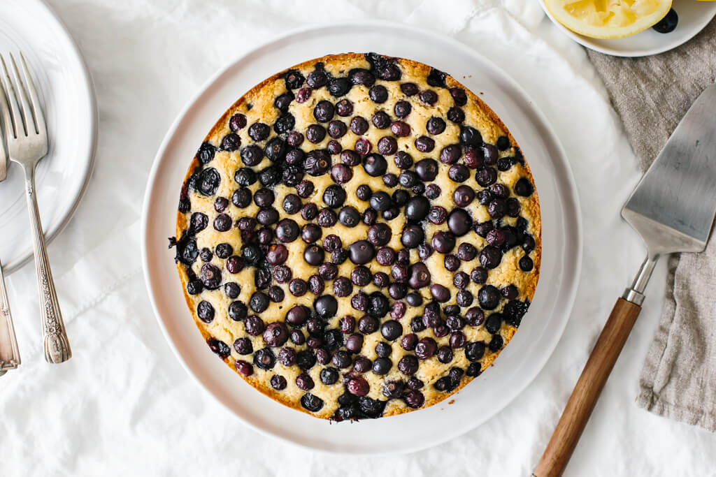 A lemon cake topped with blueberries on a table for Mother's Day