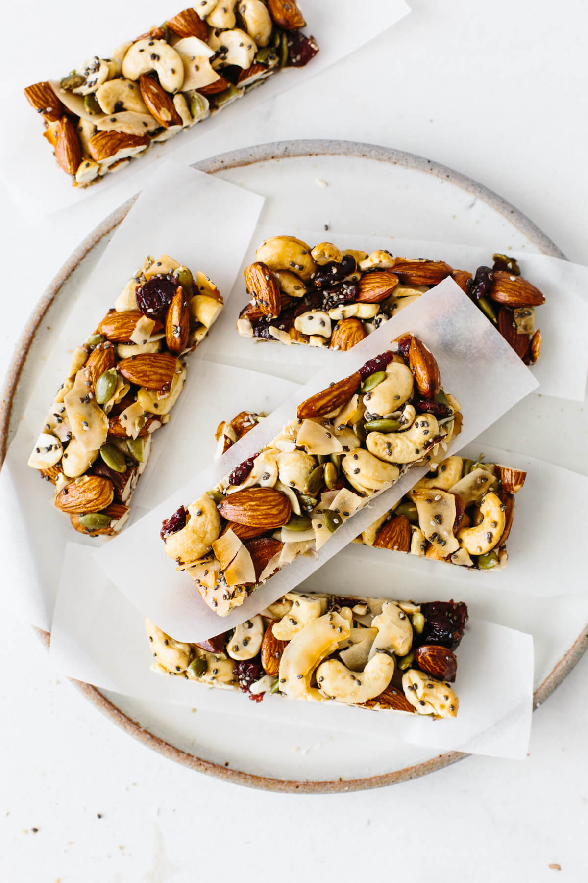 Several trail mix granola bars on a plate.