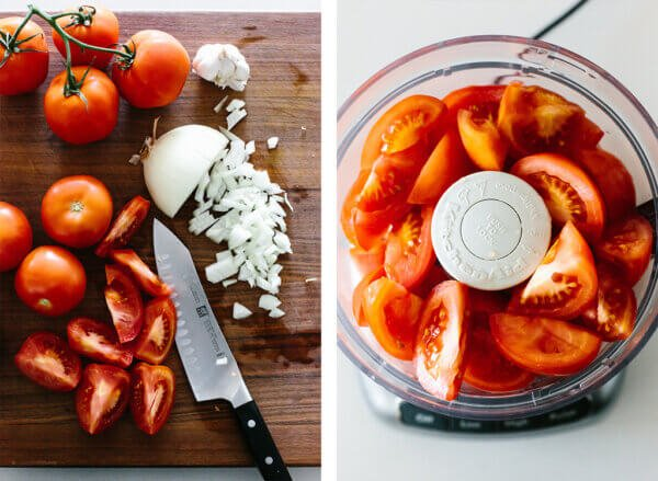Slicing tomatoes and pureeing in a food processor.