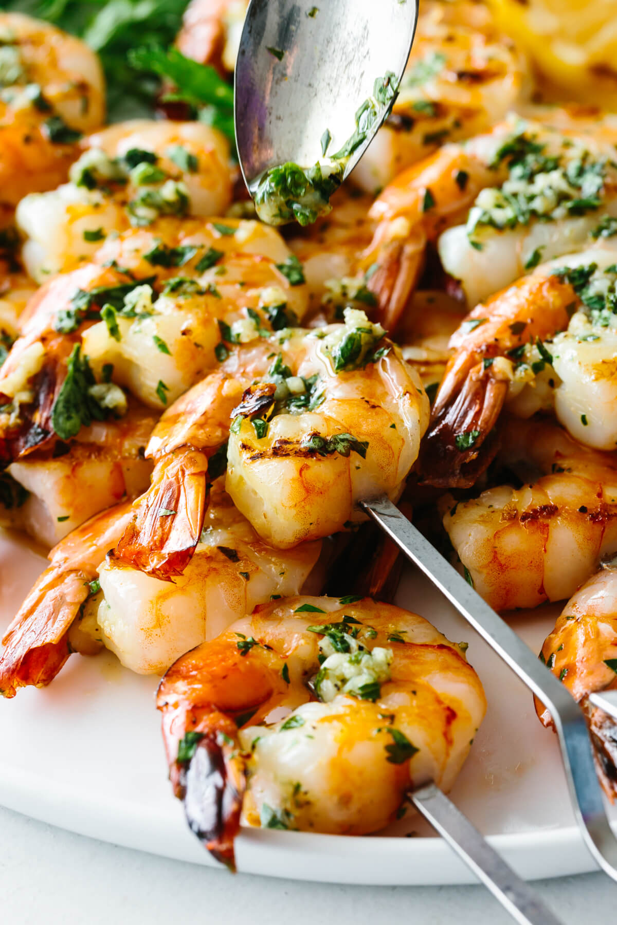 Close up photo of garlic grilled shrimp.