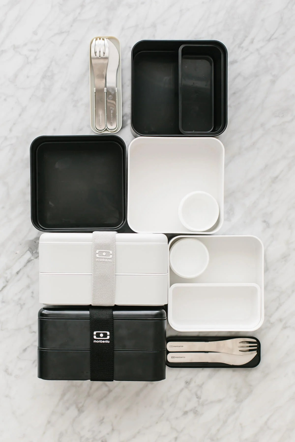 A bunch of empty bento box containers on a countertop.