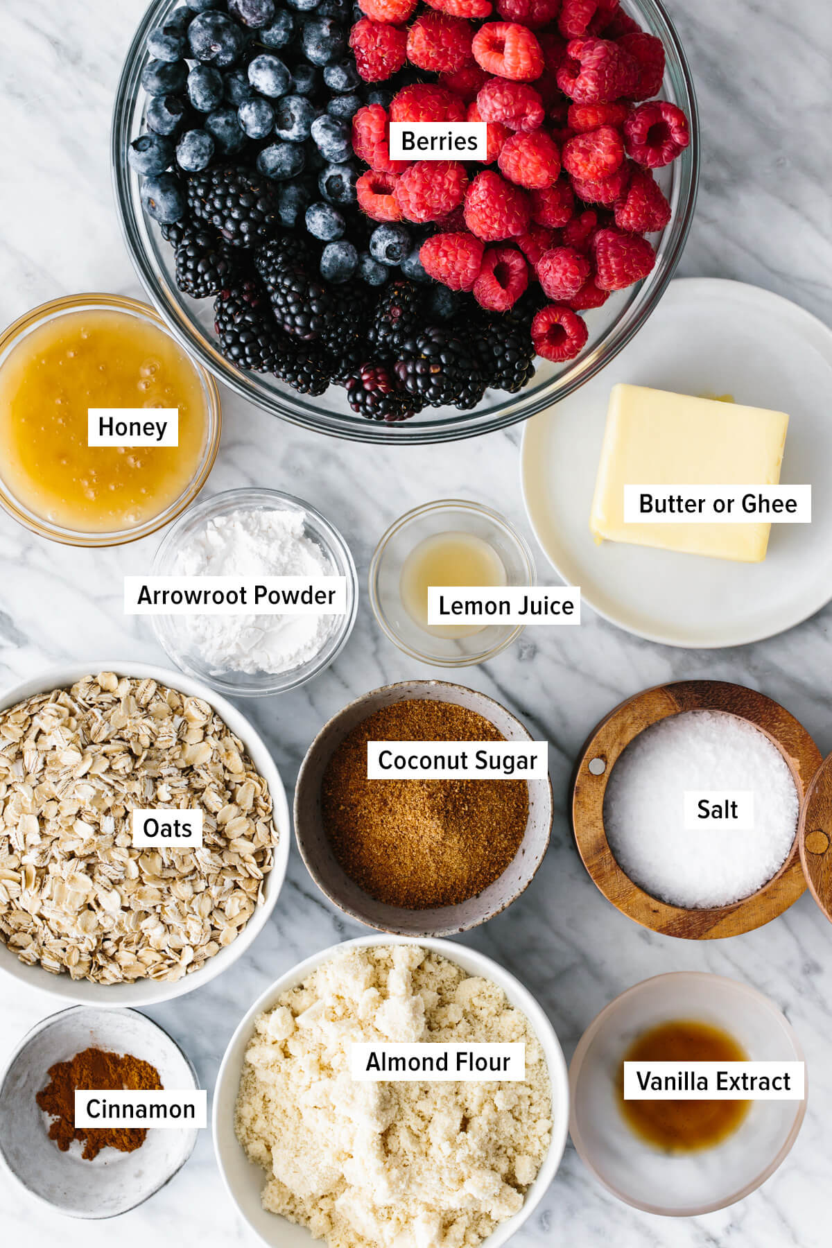 The ingredients for making berry crisp on a table.