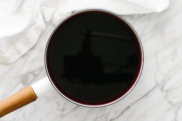 Elderberry tea in a pot, resting.