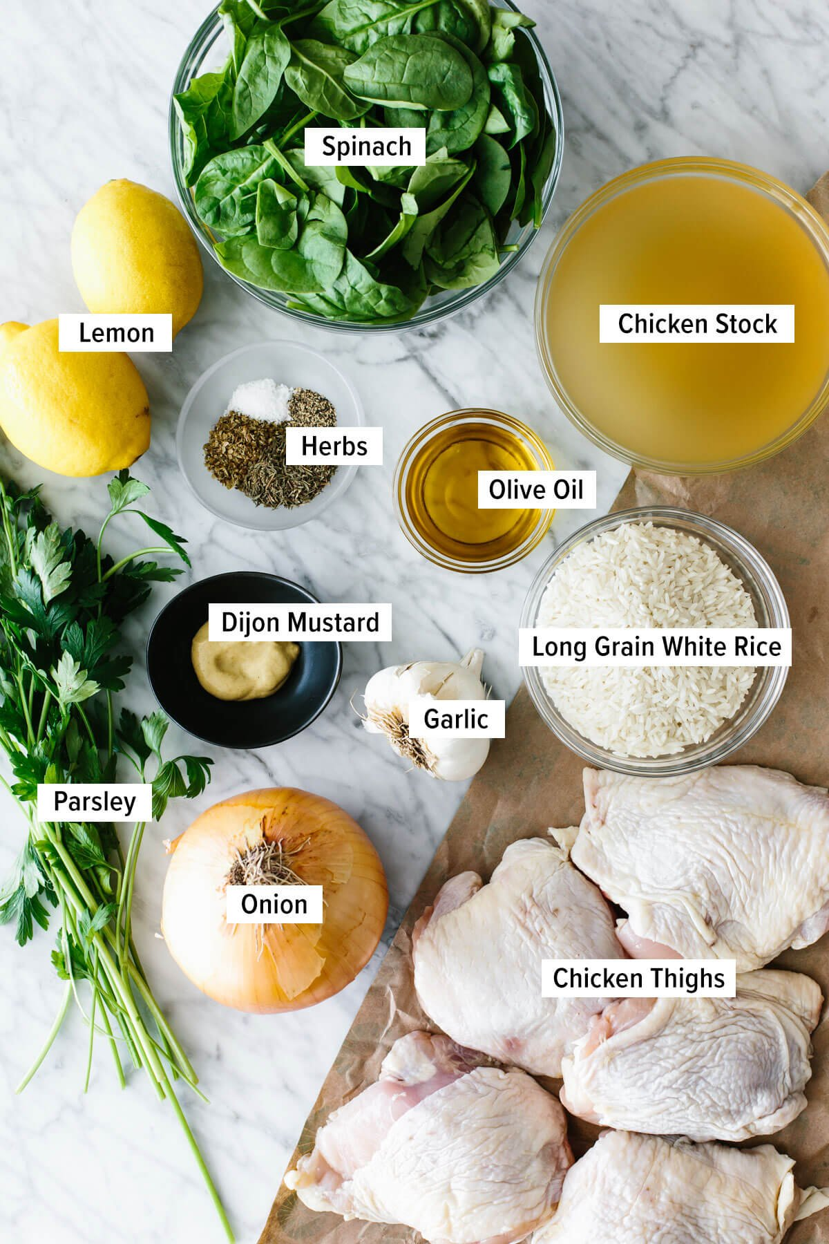Ingredients for chicken and rice on a table