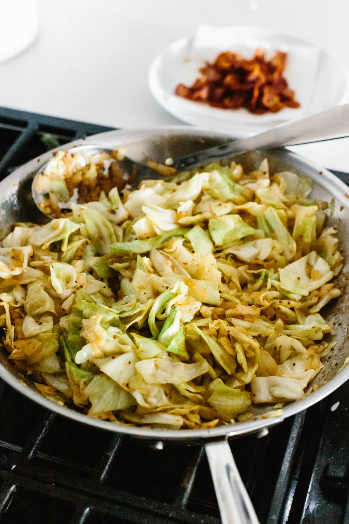 Sauteed cabbage in a pan on the stovetop.