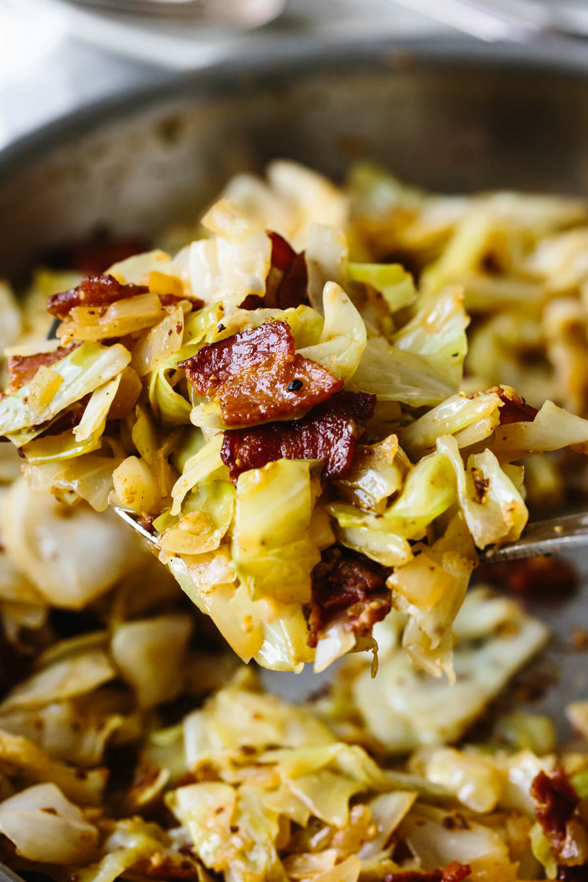 A closeup of a spoonful of fried cabbage.