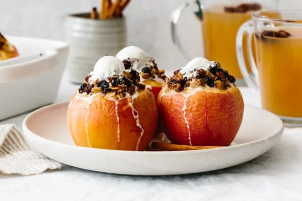 Baked apples topped with ice cream.