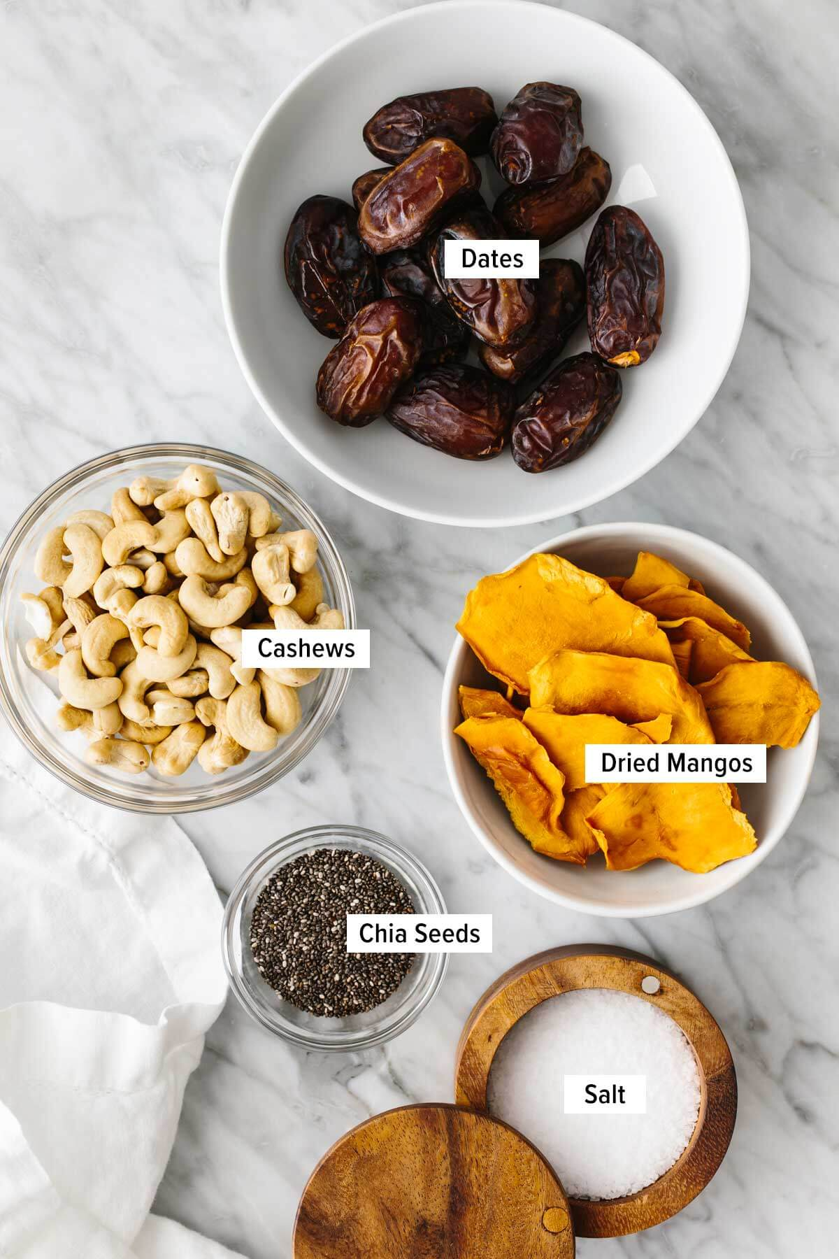 Ingredients for mango date energy balls on a table.