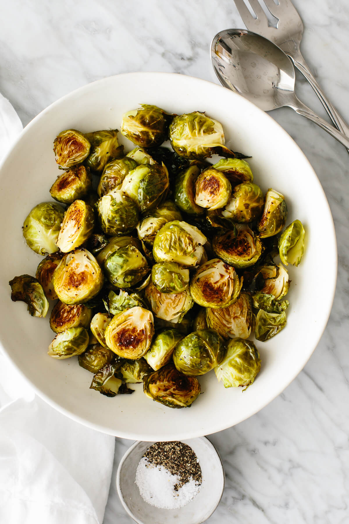 Roasted Brussels sprouts in a bowl on a table.