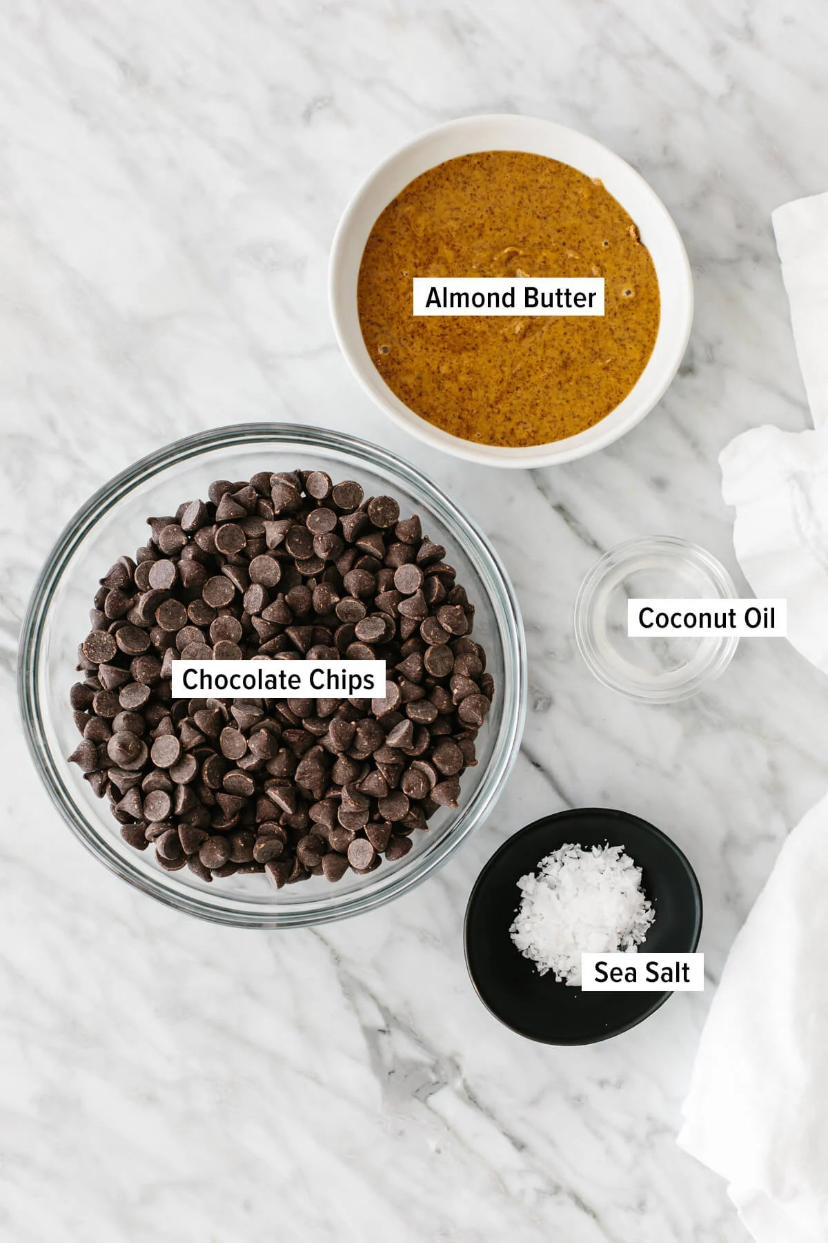 Ingredients for almond butter cups on a table.