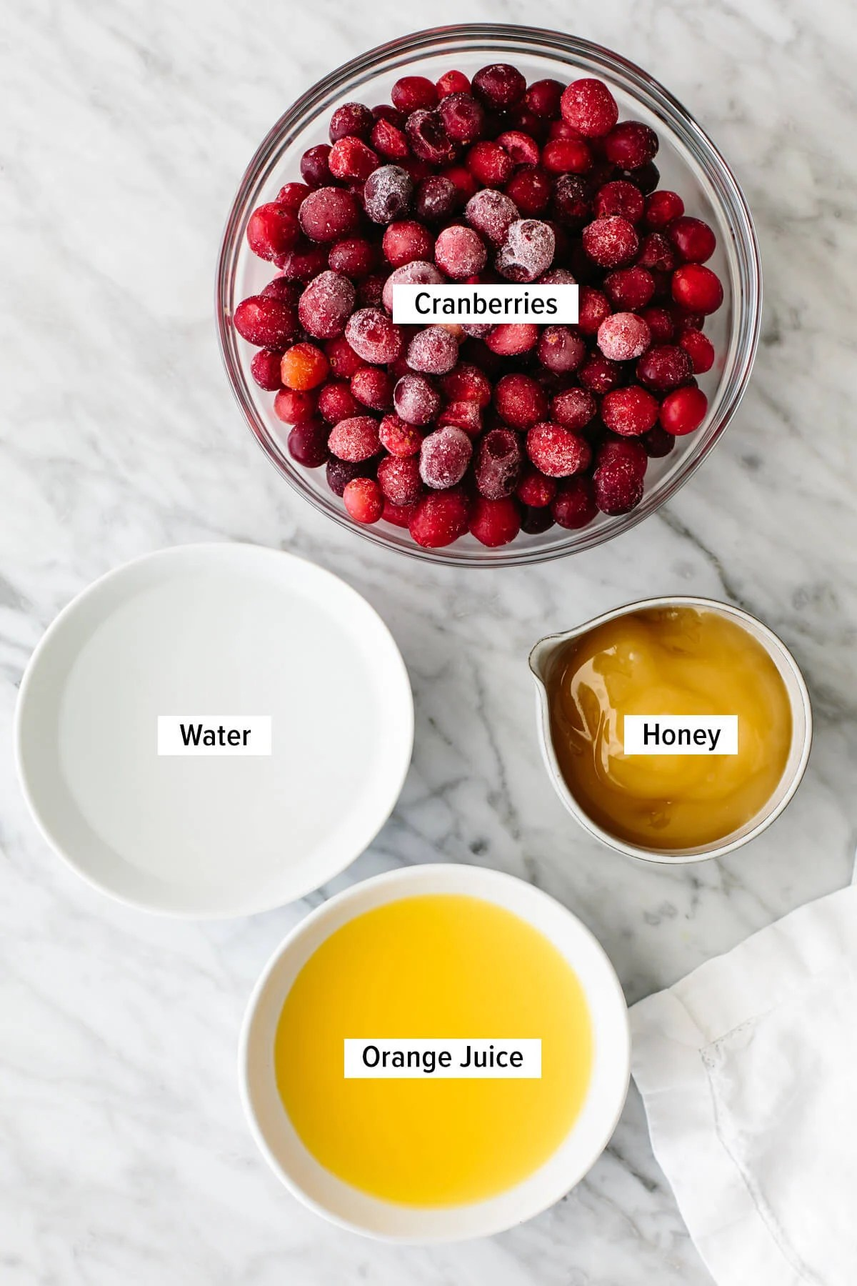 Ingredients for cranberry sauce on a table.