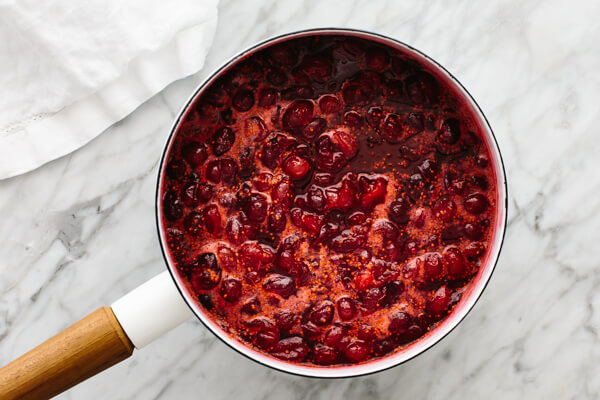 A pot boiling cranberry sauce in it.