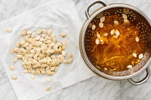 Pumpkin seeds being dried before roasting.