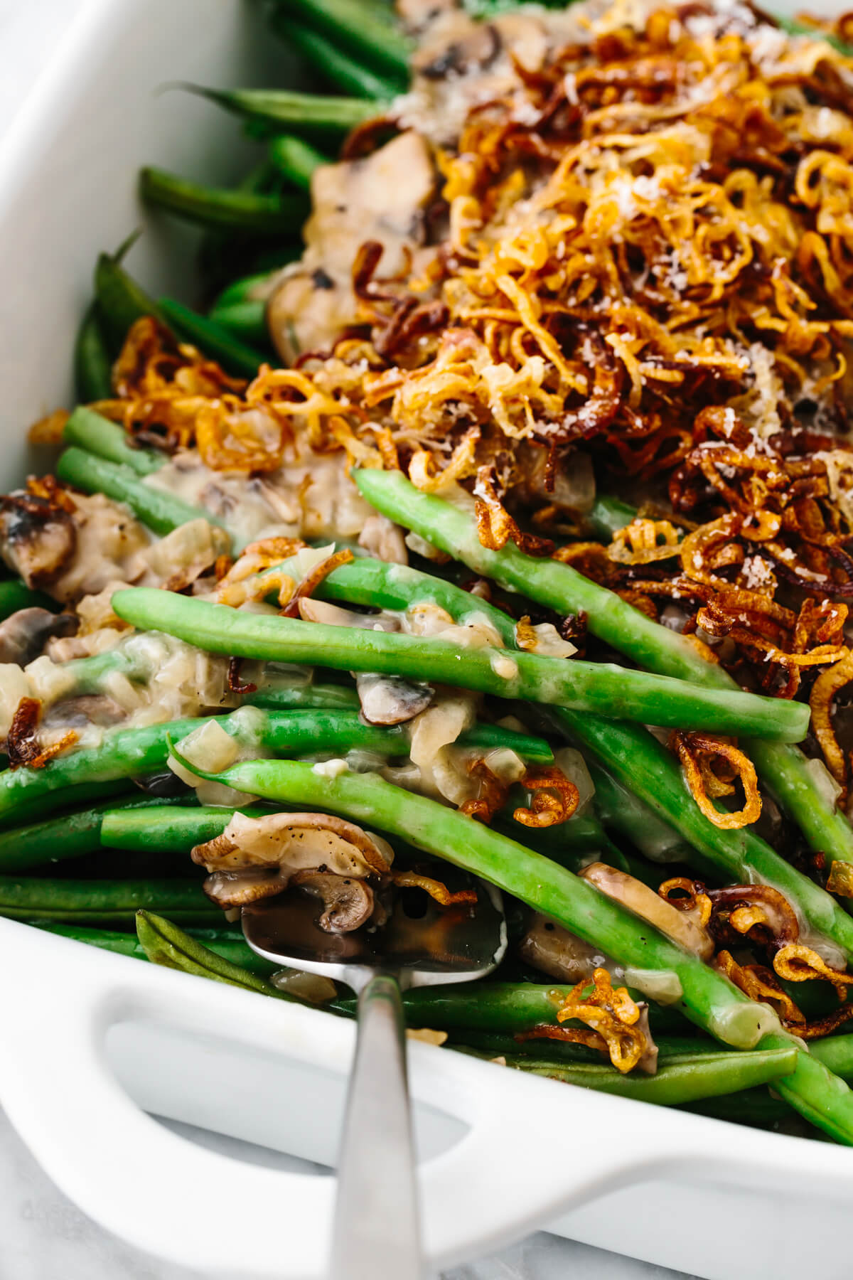 Healthy green bean casserole in a white dish.