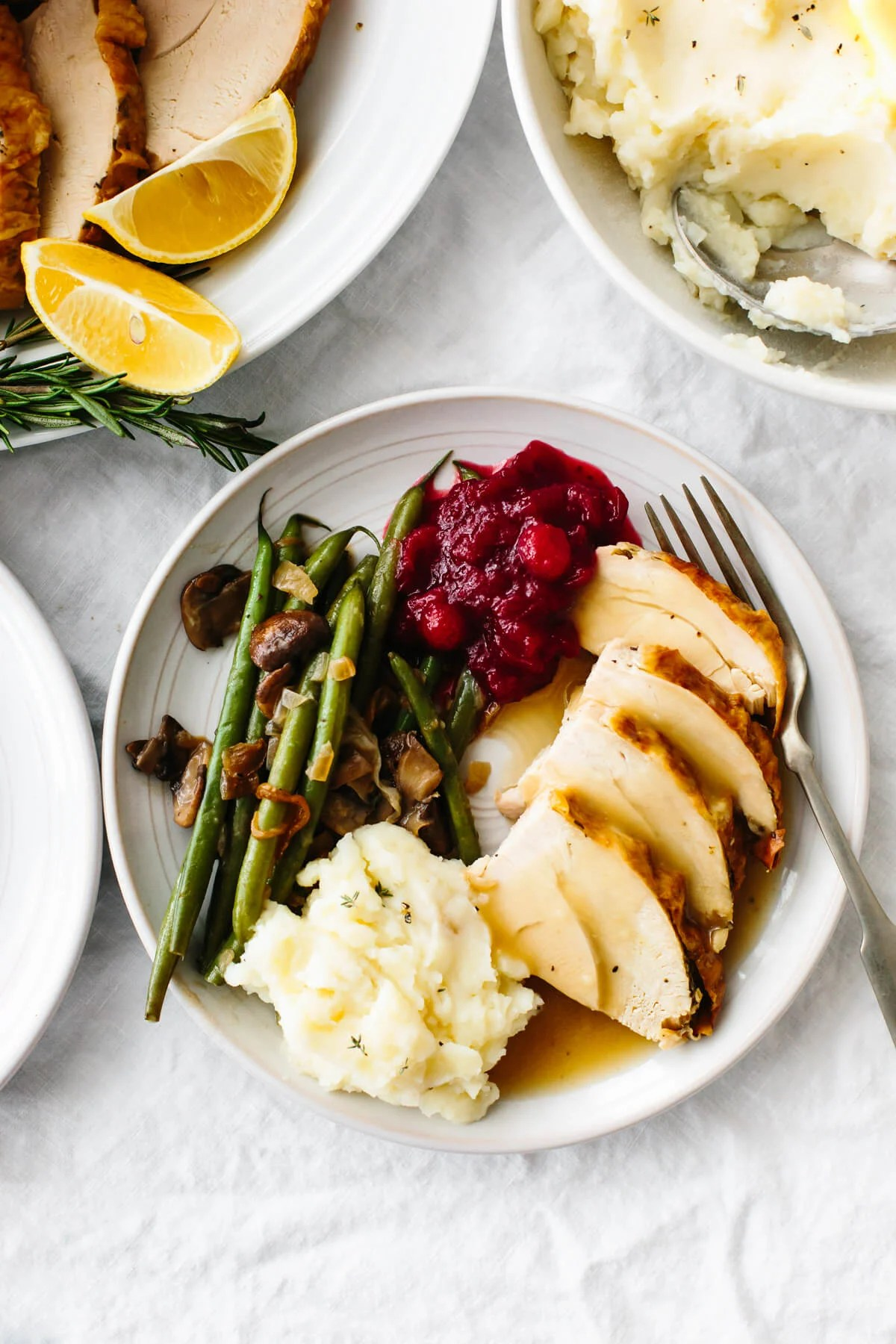 A plate of Thanksgiving side dishes and roasted turkey.