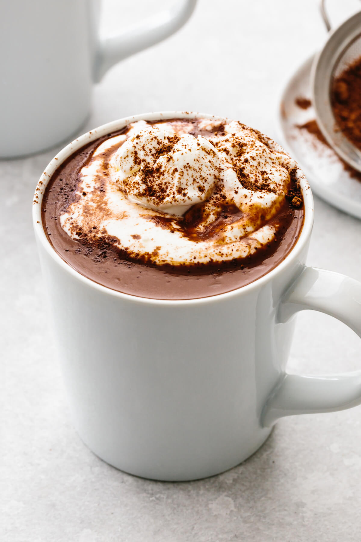 Hot chocolate in a white mug on a table.
