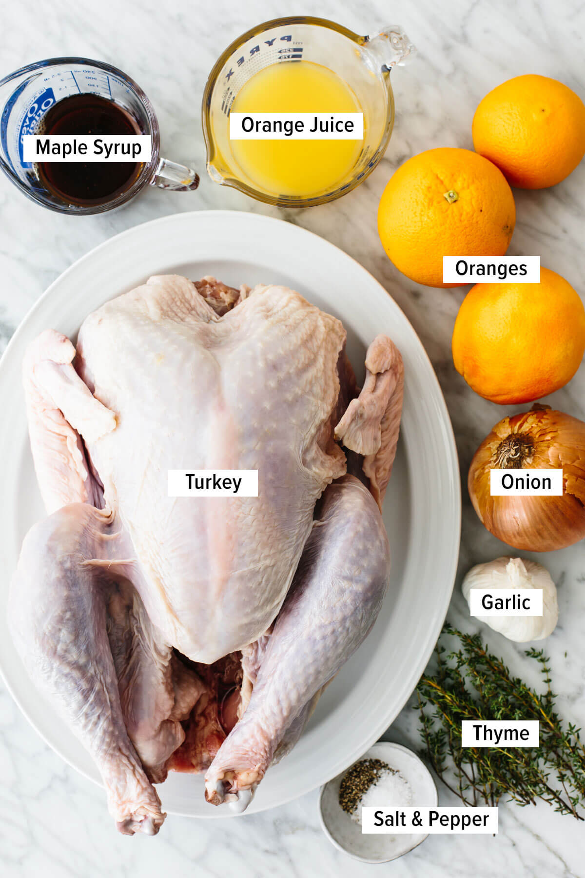 Ingredients for a maple orange glazed spatchcock turkey on a table.
