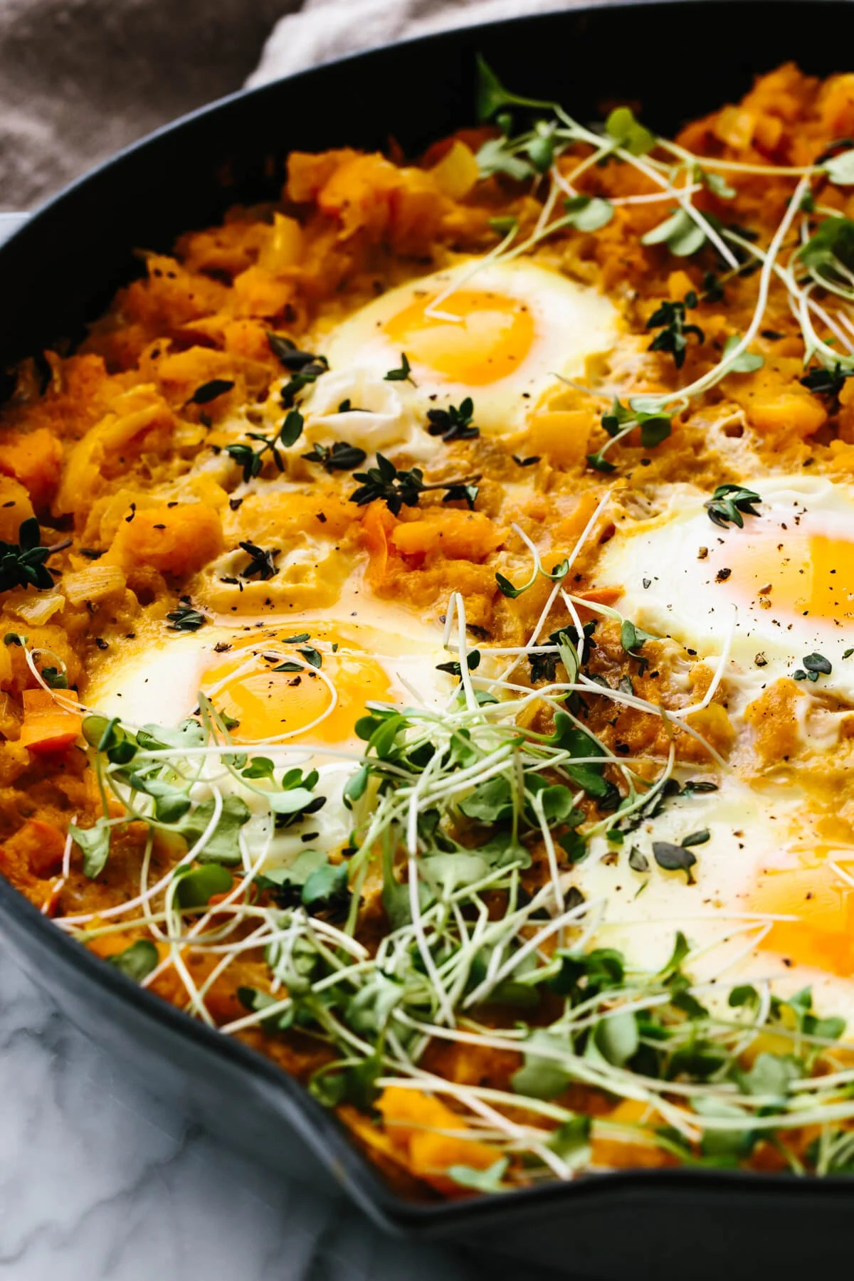 A skillet with orange shakshuka.