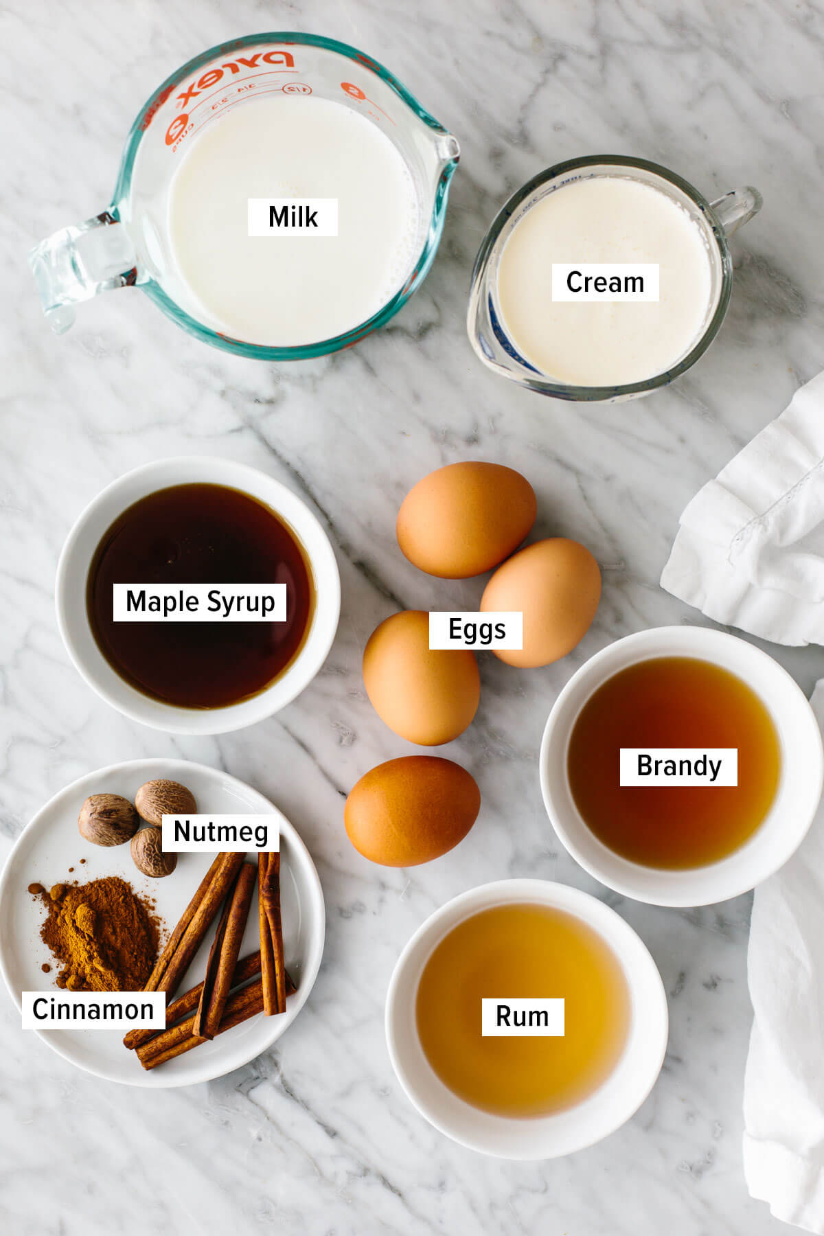 Homemade eggnog ingredients on a table.