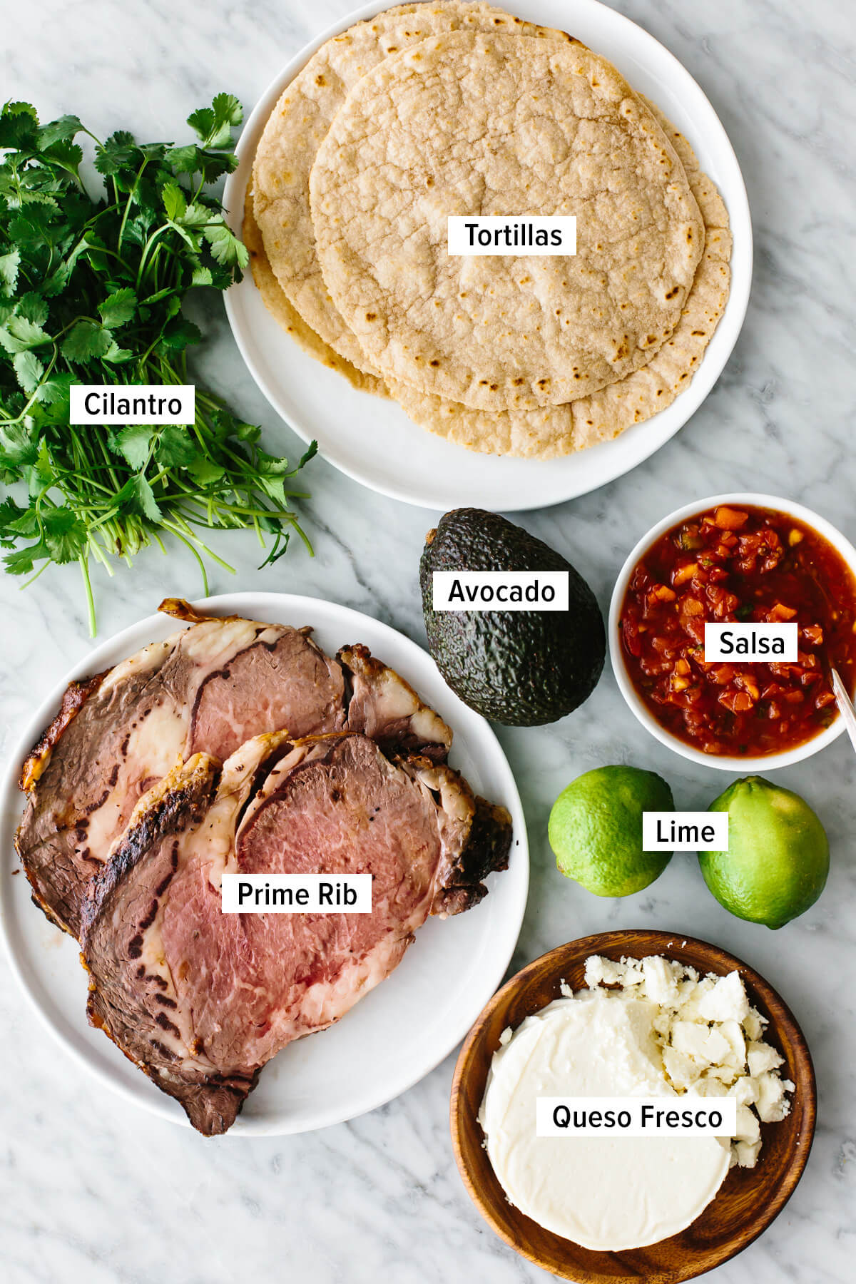 Prime rib taco ingredients on a table.