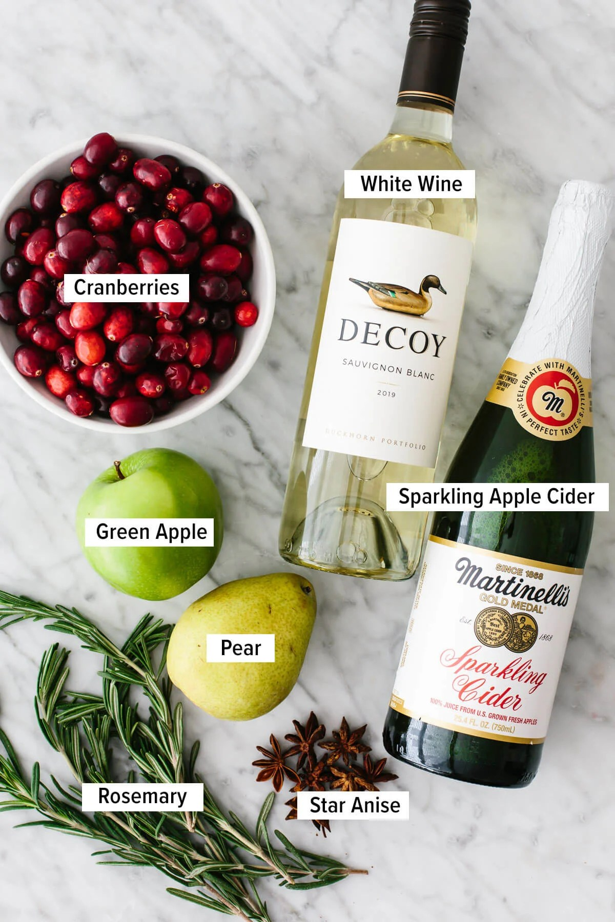 Ingredients for a white Christmas sangria on a table.