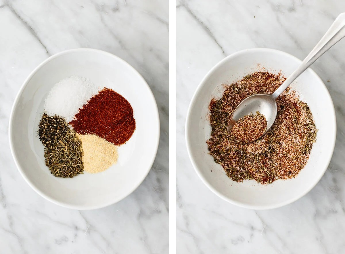 Mixing a spice blend in a bowl for baked chicken breasts.