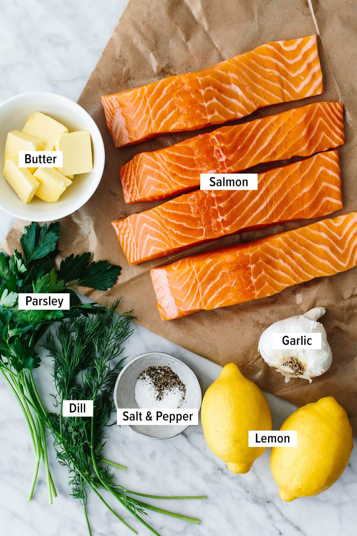 Ingredients for baked salmon on a table.