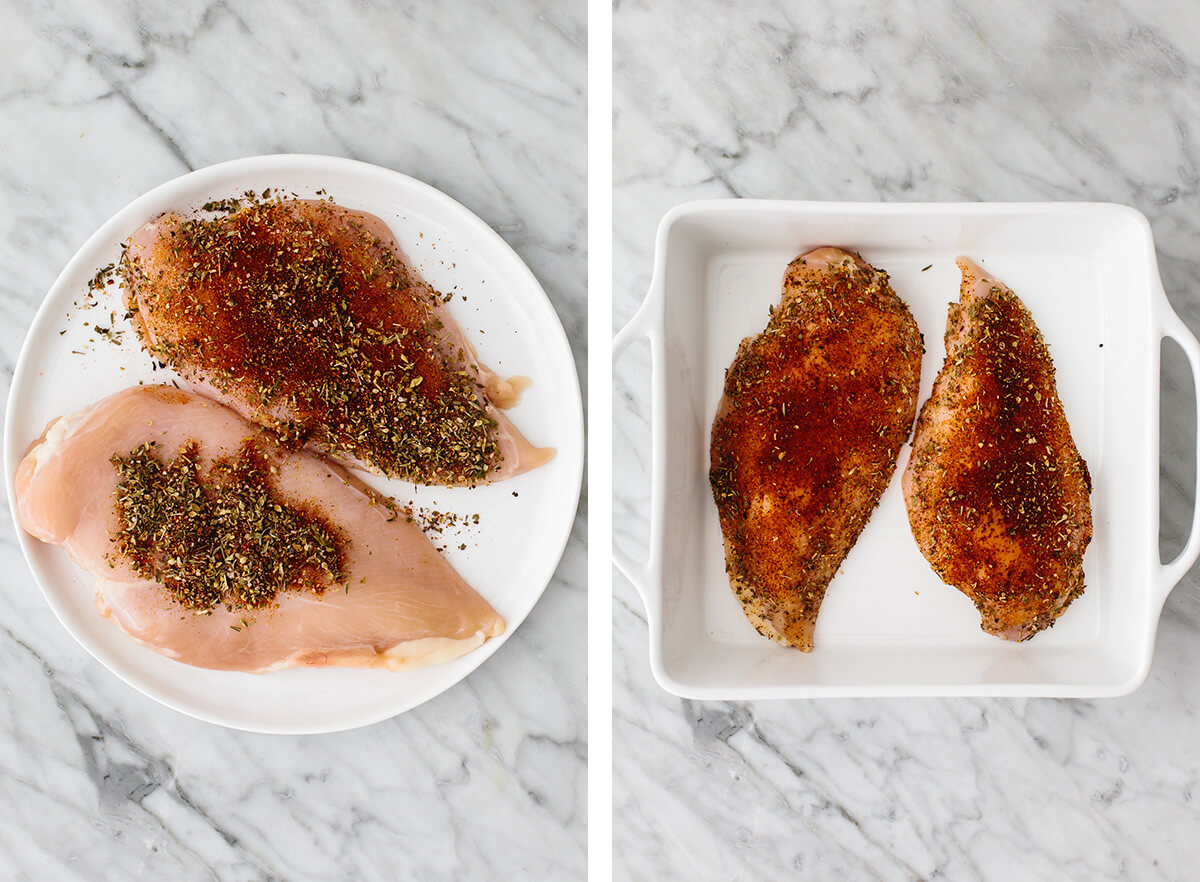 Two chicken breasts coated in spices in a baking dish.