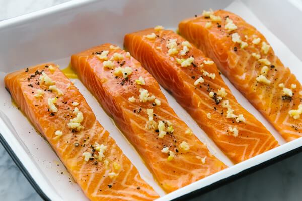 A pan with baked salmon fillets.