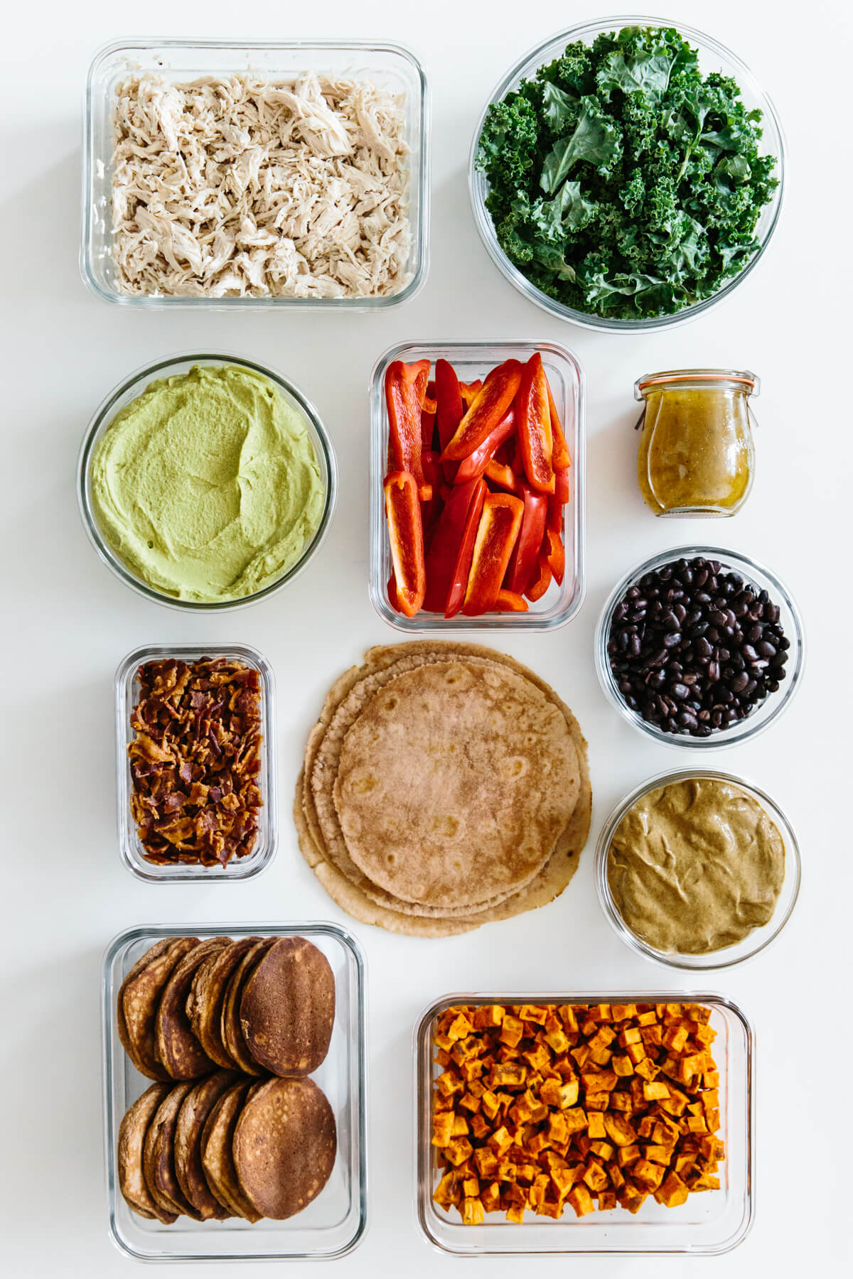 Meal prepped individual ingredients in containers.